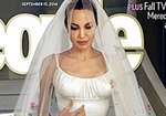 Angelina Jolie's embroidered wedding dress makes headlines