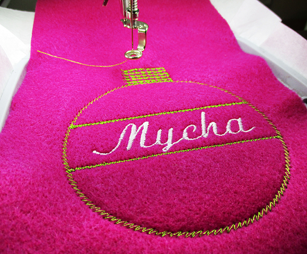 stitching personalized Christmas gift tag